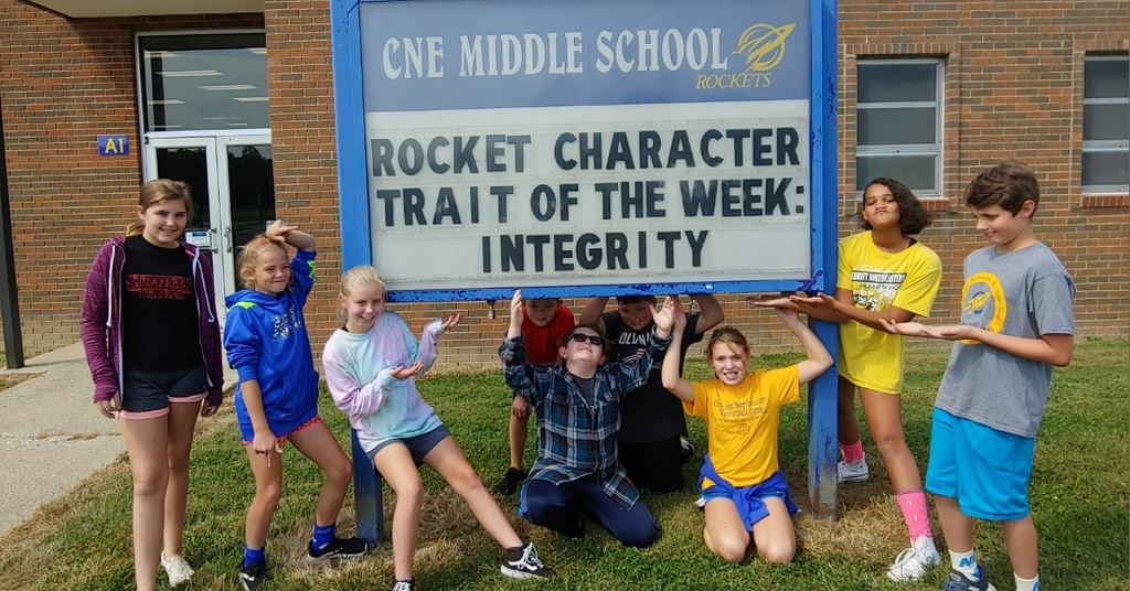 6th Graders displaying SCHOOL PRIDE while showing our Character Trait of the Week!!!