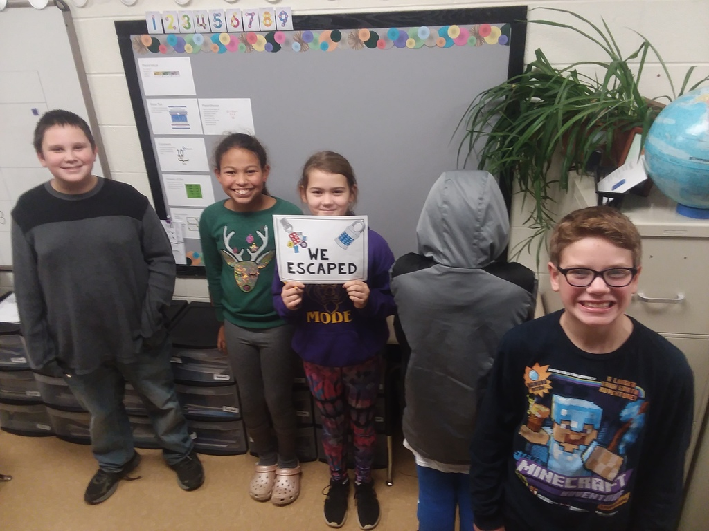 More students working out math problems to escape the Dragon Multiplication Escape Room.
