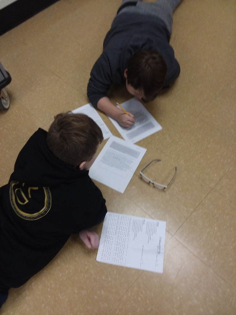 Fifth graders peer editing.